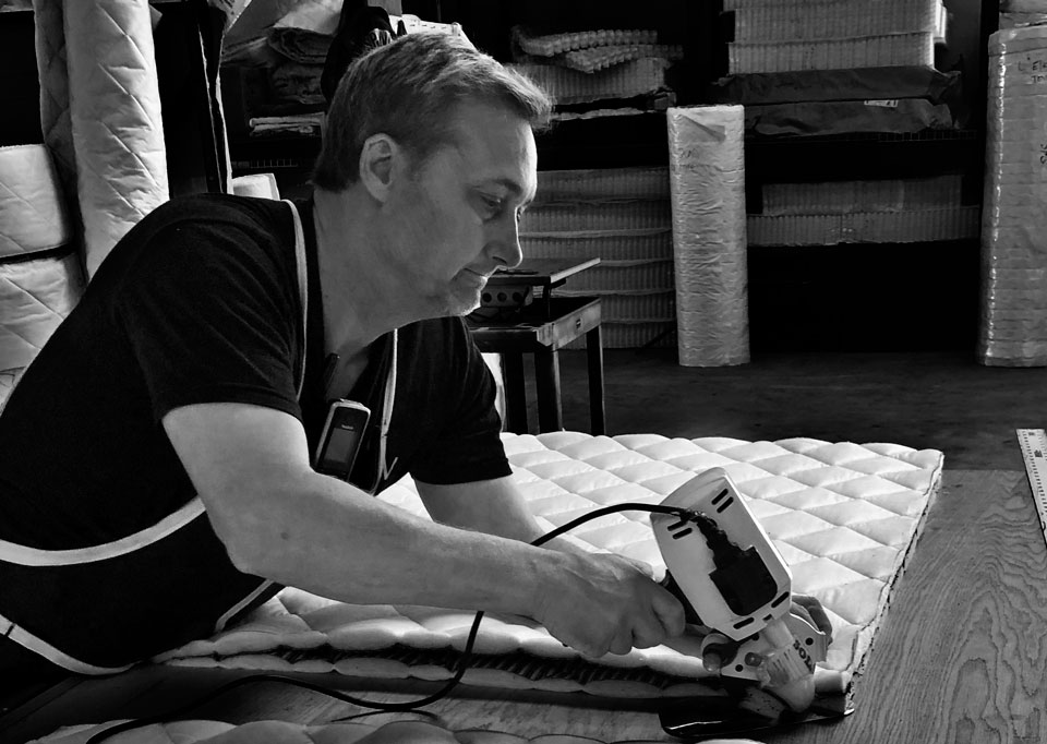 Spencer working hard making locally hand-crafted mattresses